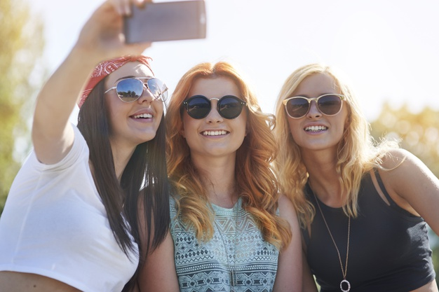 girls-having-fun-skatepark_329181-12954
